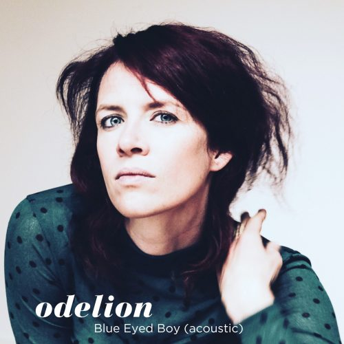 Cover of Blue Eyed Boy, acoustic version - Odelion. Image of Margriet Sjoerdsma who looks in the camera. The title and band are displayed on the front.