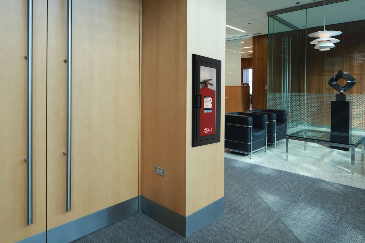 Oval Brand Fire Extinguisher Model 10JABC installed in a Second Floor Reception - Black Cabinet