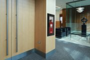 Oval Brand Fire Extinguisher Model 10JABC installed in a Second Floor Reception – Black Cabinet