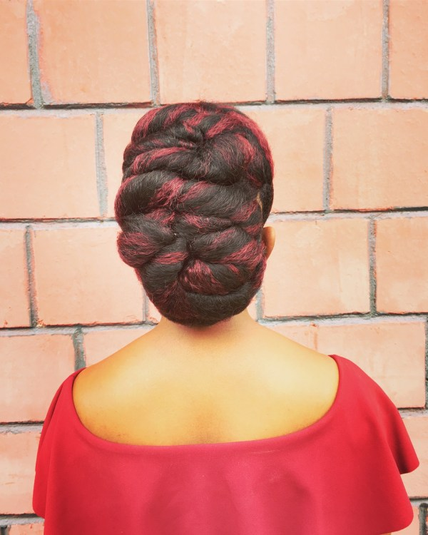 Olive tree hair stylist wearing definition hair in 99J