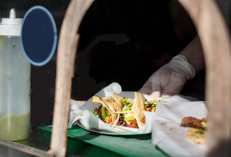 Tacos being served at a taco truck