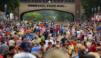 A large crowd walked along Liggett Street on the opening day of the Minnesota State Fair in Falcon Heights, Thursday, August 23, 2012. (Pioneer Press: Chris Polydoroff)