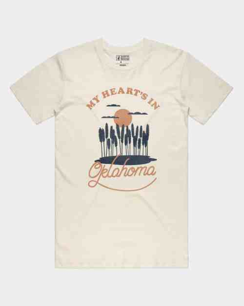 "A natural tee that says 'My heart's in Oklahoma"" in an orange in"