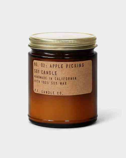 A soy candle in a brown jar with an apple scent