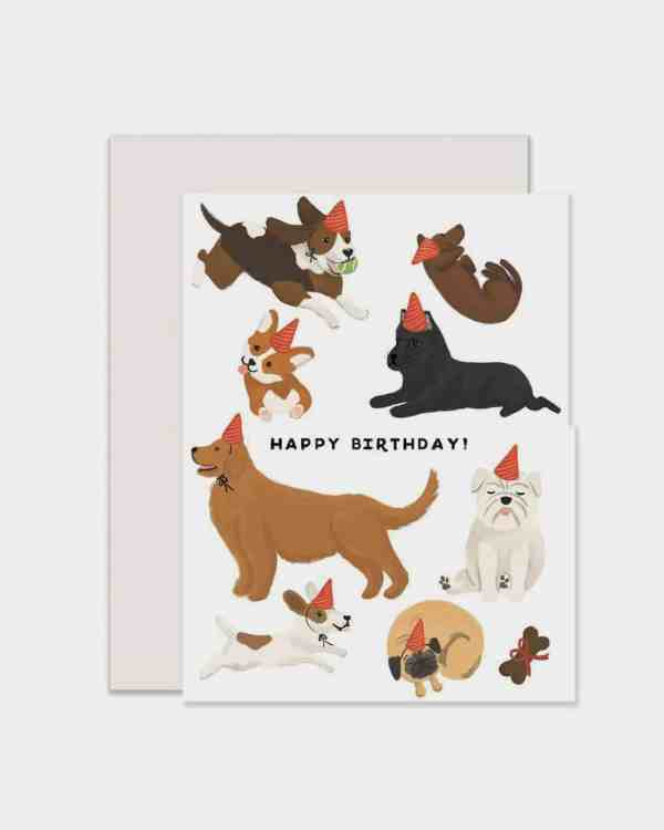 White card that says 'happy birthday' with dogs on it