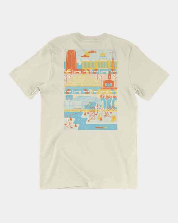 A natural tee that says 'it's fun in okc' in blue, yellow, & orange