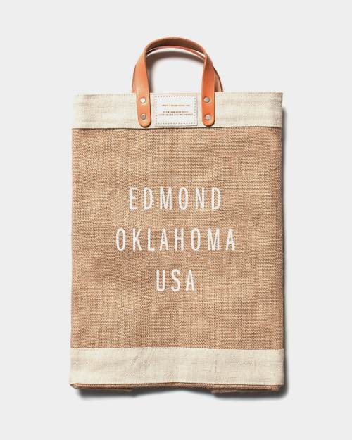 A brown canvas, reusable bag that says Edmond Oklahoma USA on it