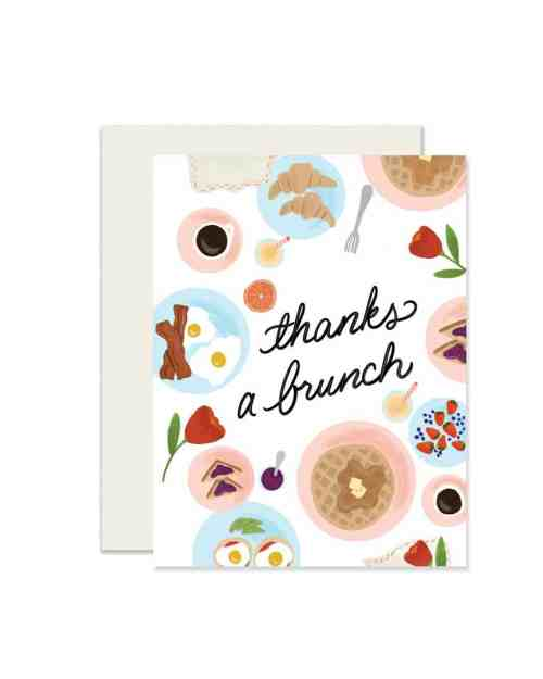 A white paper card that says 'Thanks a Brunch' on it surrounded by foods