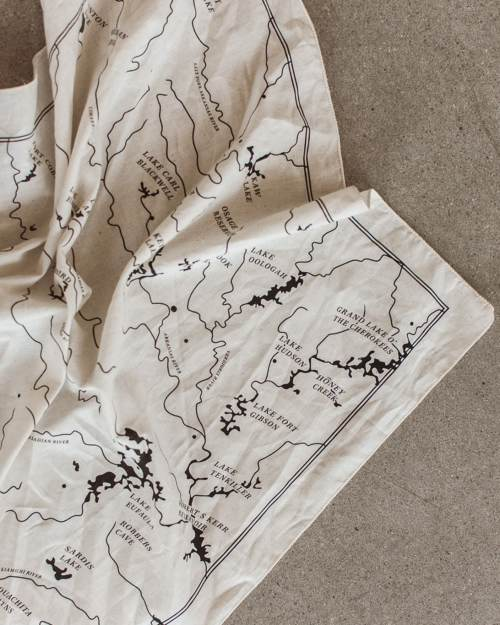 A map of the Oklahoma river system printed in black on a natural colored bandana.