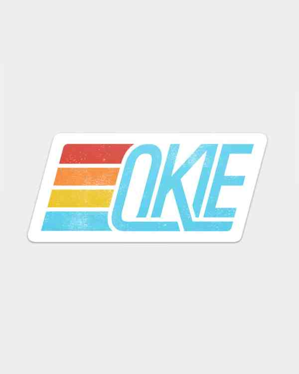 A four color sticker design that says Okie.