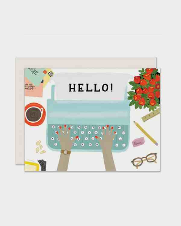 White card with a typewriter on it that says 'hello'