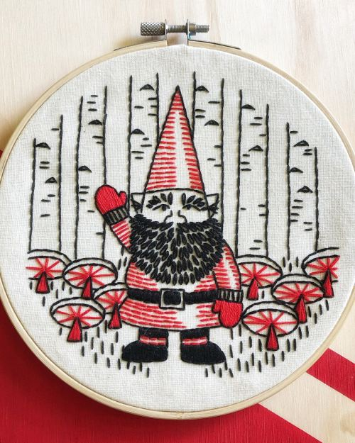 A photo of a red, white and black Friendly Forrest Gnome Embroidery Kit