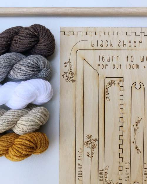 A photo of a DIY tapestry set withorange, white, gray and brown yarn