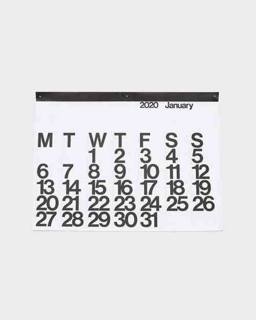 A mockup of a 2020 Stendig Calendar with a white page and black numerals