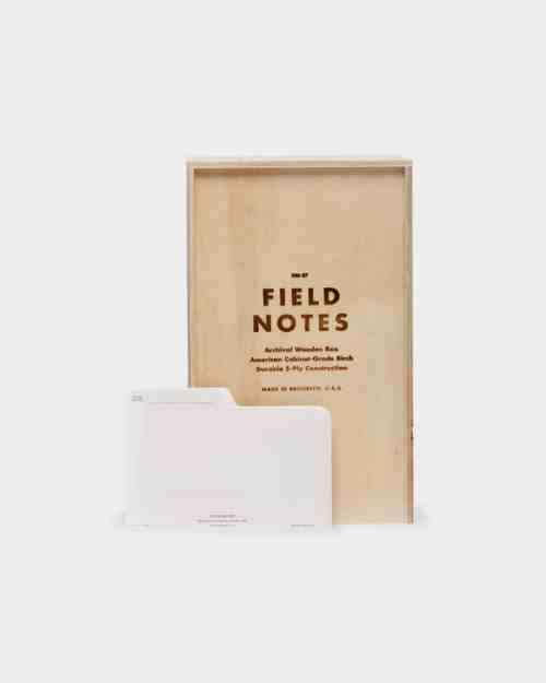 "Brown wooden box that says ""Field Notes"""