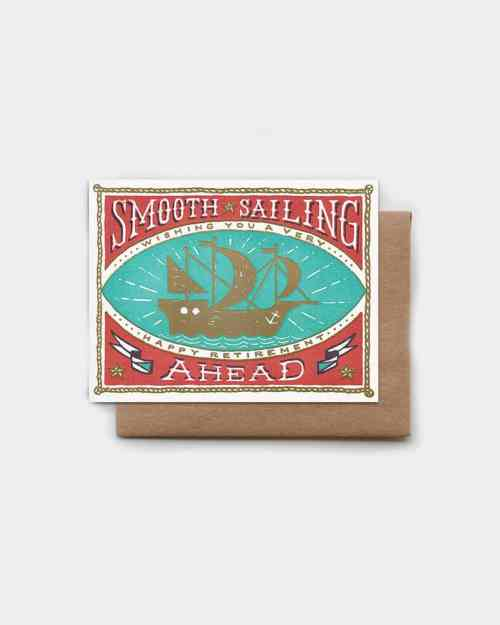 "White card with a boat on it that says ""wishing you smooth sailing"""