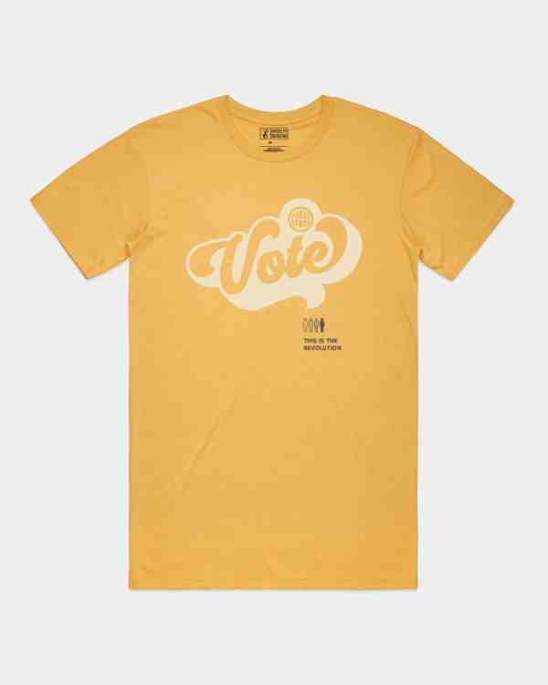 Mustard tee with Vote printed in khaki ink