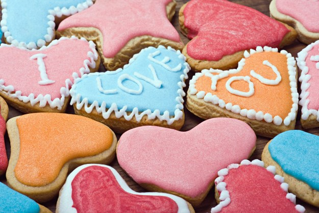 graphicstock-valentine-cookies-with-the-words-i-love-you-on-the-table_rQEQeUufhl.jpg