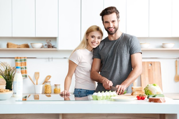 storyblocks-married-young-couple-enjoying-their-time-at-home-while-cooking-in-the-kitchen_rRMNmaoTcW-1.jpg