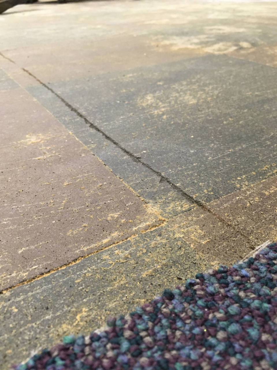 While we'd hoped the checkerboard subfloor could be revived, we'll settle for knowing this design element from the old shop is also underfoot in this new space...