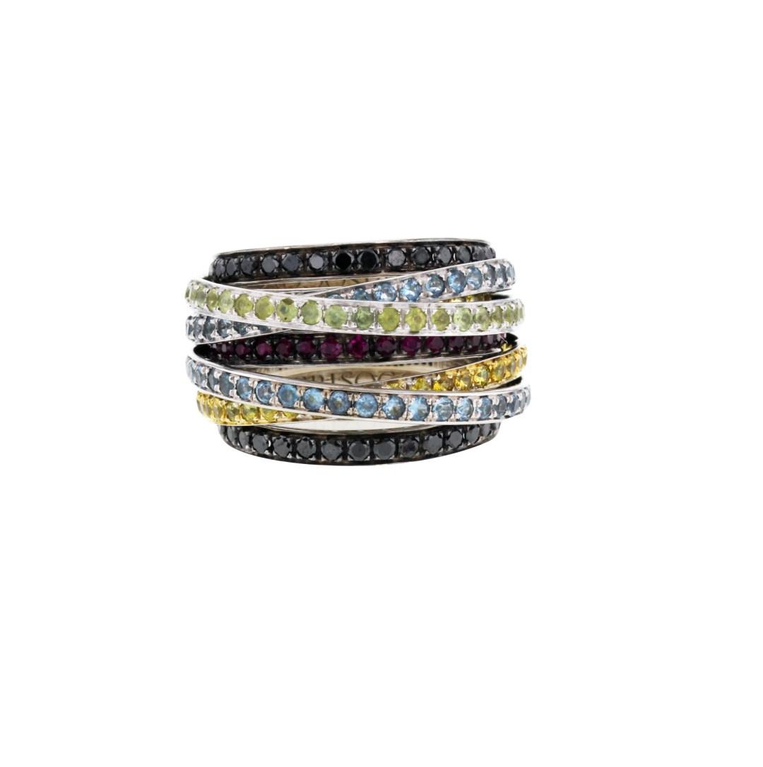 De Grisogono • Haute en couleur! Sublime bague de la collection «Allegra» en or blanc & noirci et en pierres de couleurs. Une superposition de neuf bandeaux bombés entièrement sertis de pierres de couleurs de taille ronde. 5 900 € (réf. 291423)