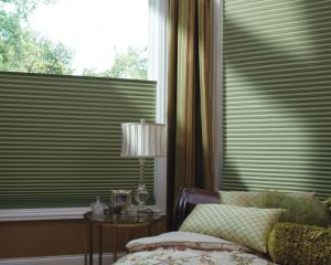 An example of window shades that move up from the bottom, instead of down from the top, in a restful green bedroom setting. Photo via WindowProductsCT.Com