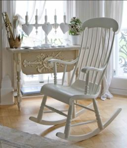 An iconic cottage themed rocking chair in a style easily found at thrift stores and painted to your liking