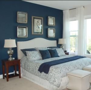 Intense color on just one wall creates drama and dimension with framed art and the bed headboard. MidcityEast.Com