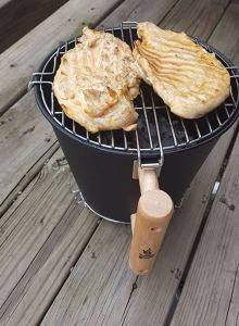 Firefly 9-inch grill. Designed to start charcoal quickly, the hinged grill and handle make this a perfect adaptable option for 1-2 vagabonds.