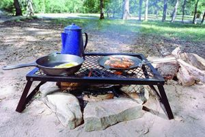 Texsport Heavy Duty Over the Fire Grill has folding legs. Use as a table when not grilling.