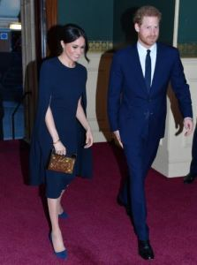 Meghan demonstrates two fashion tips: A monochromatic theme, and the 2/3 - 1/3 trick. Colored heels work here because of the unified color scheme, the length of her legs, and the similarity between the shade of her hair and the color of the heels, which ties her full look together. A handsome prince is always a great accessory as well.