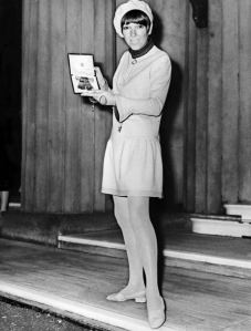 Mary Quant receiving the Order of the British Empire Medal for designing the mini skirt. Well, for her 'contribution to British Fashion'.... Notice she is also rocking a beret. Photo via nydailynews.com.