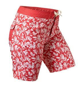 Matching Board Shorts are cute, girly, and smart. Velcro fly combines with elastic waist and front tie for great fit. Keep your stuff safe in the Velco flap back pockets. Dual side pockets, too. Pockets have grommets for draining. UPF 50+ fabric in a variety of colors and prints. uvskinz.com.