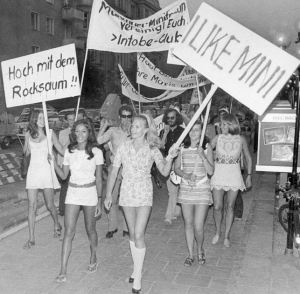 Munich, 1970: Women march in protest of fashion retailers promoting maxi length skirts. These Shoppinggirls demanded more mini skirts in the shops instead. Photo via nydailynews.com.