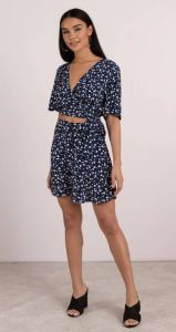 Every Shoppinggirl can use a mini like this Navy ditsy floral with a button front. Buy the matching top to make a cute set. Minkpink Shady Days skirt at tobi.com.