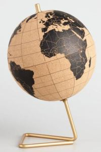 Globes are excellent decor items for a student's desk. A globe has a way of triggering a study state of mind. Many globes include features that make them extra-practical, such as this one made of cork, which comes with a set of 50 red-topped pins. Use it to mark places you are learning about, where you'll be doing your summer-break travel studies, or as a 3-dimensional bulletin board. It spins for ease of use, and it looks cool. Worldmarket.com.