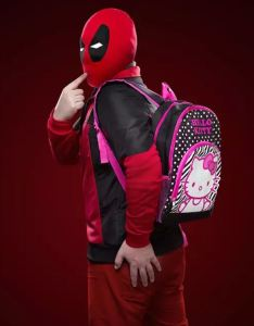 It's Deadpool's Hello Kitty Backpack! Now you can carry your Glock and stuff just like Deadpool does. Don't forget drinks for Trick-or-Treating kids; they get thirsty throwing rotten eggs at houses that hand out teensy boxes of raisins. thinkgeek.com.