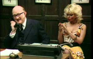 """I can't use Technology...I might break a nail."" Candy Davis as Miss Belfridge, shown here with Nicholas Smith, from the hilarious vintage television series ""Are You Being Served?"""