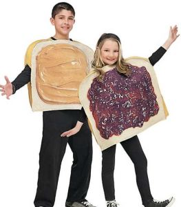 """Group costumes are great for families and friends. Try the realistic graphics on this Kids' Peanut Butter n' Jelly Costume Set for safe, easy-to-wear Halloween humor for twins or pals. This kind of costume will not get in the way on carnival or theme park rides. Got more than two kids or buddies? Buy several sets, and cover the PB&J graphics with differently delish-or ghoulish-sandwich """"fillings"""". orientaltrading.com."""
