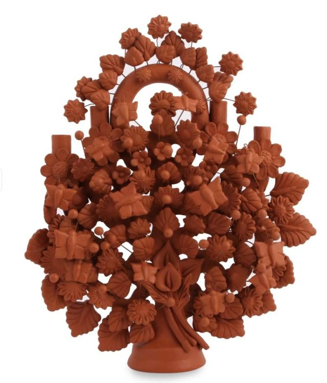 """National Geographic's fair-trade online store, Novica, features many delightful decor items. """"Wonderful Spring"""" candelabra, by Magdaleno Fierro of Mexico. novica.com"""