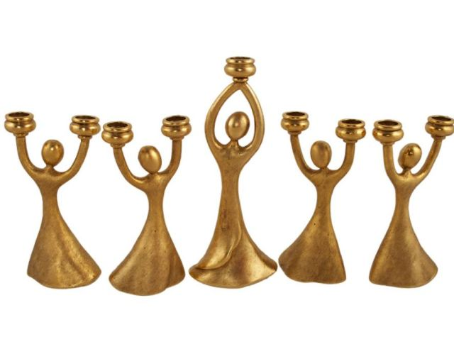 Joyous Dancing Menorah Set in Goldtone. https://www.traditionsjewishgifts.com/menorah-hanukkah-joyous-dancing-metal-quest-gift-QUMEN34A.html