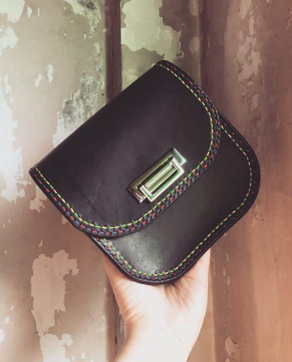 structured black leather evening bag
