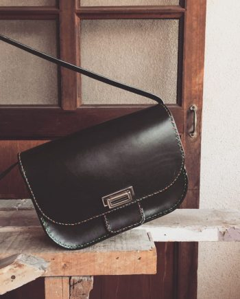 structured black leather box bag
