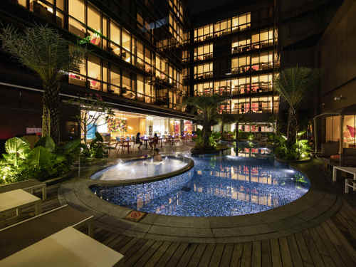 Outdoor freeform swimming pool at Ibis Styles Singapore On Macpherson hotel.
