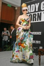 Gaga sports an artsy Naeem Khan gown and retro beehive updo at a press conference in New Delhi on October 28, 2011.