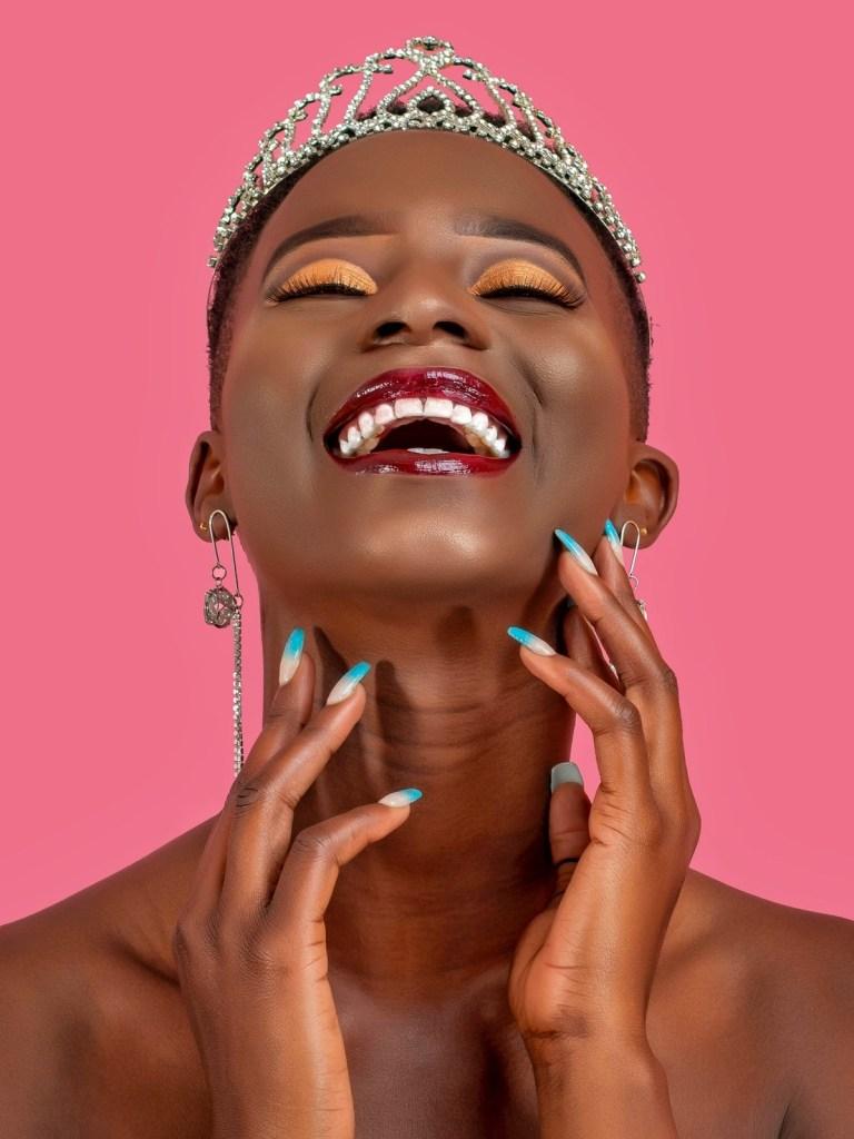 A woman wearing a tiara crown