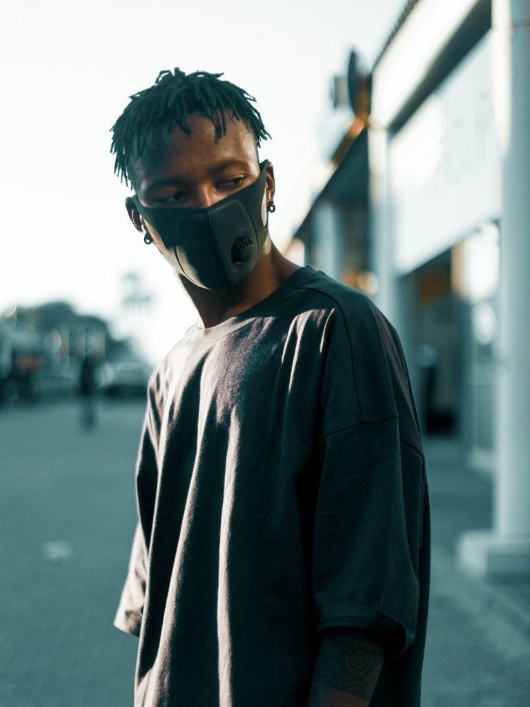 Picture of a black man wearing a face mask.