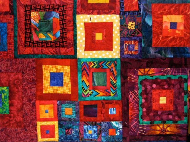 A colorful quilt with patchwork