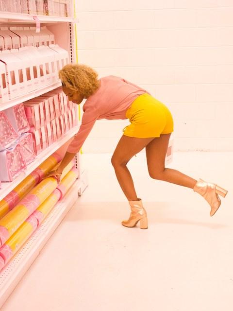 A black woman wearing shorts