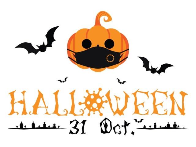 A Halloween themed poster with a pumpkin, face mask, bats, graveyard and Oct. 31 date.